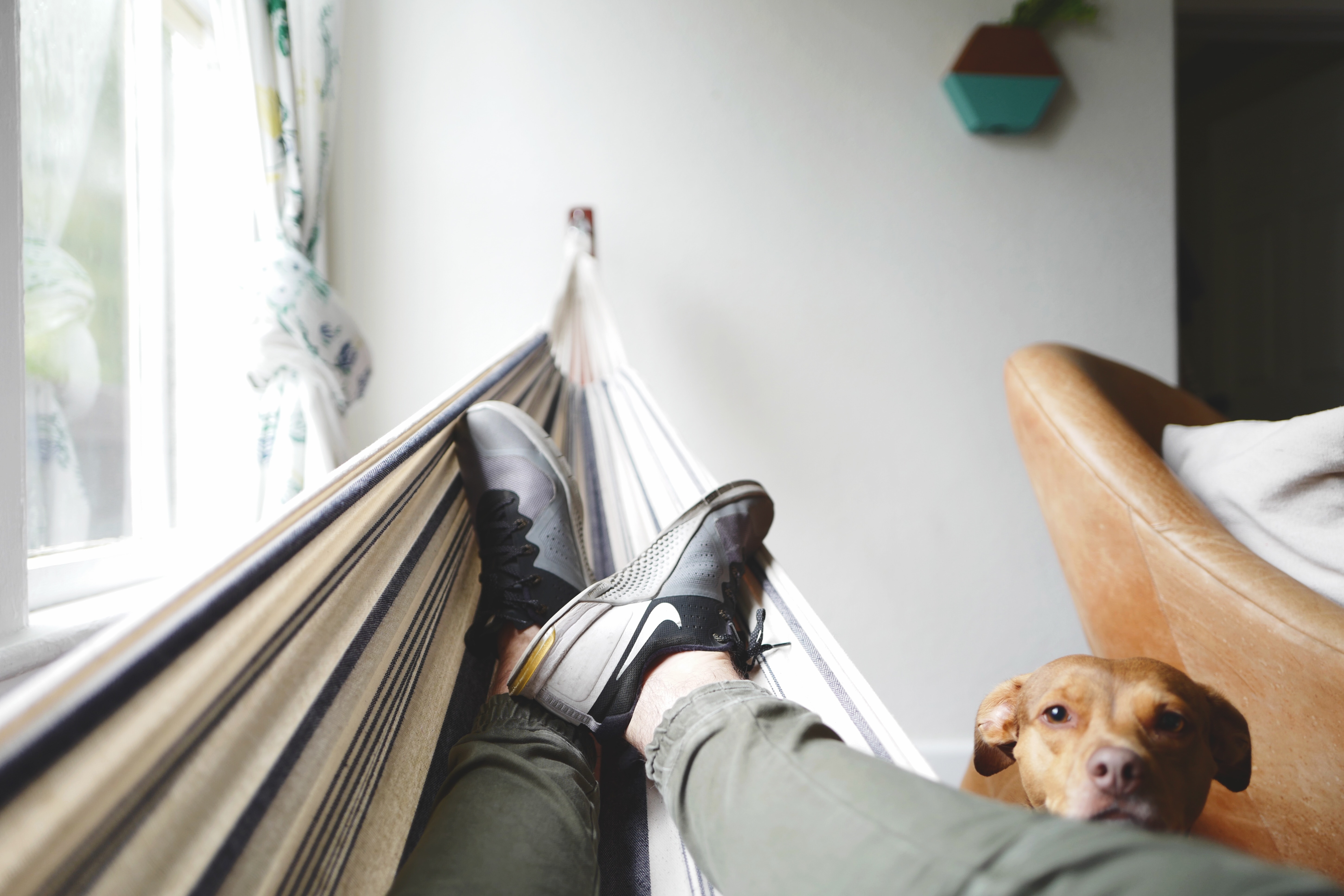 A person relaxing in his hammock | HVAC contractor | A Plus Air Conditioning and Refrigeration