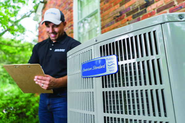 A technician assessing an American Standard cooling system | AC Repair in Gainesville, FL